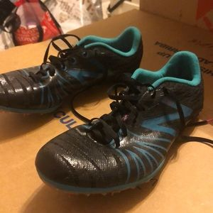 Worn once new Balance track spikes